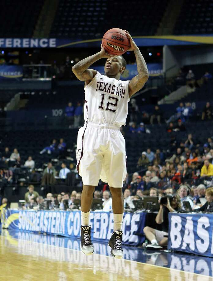NASHVILLE, TN - MARCH 13:  Fabyon Harris #12 of the Texas A&M Aggies shoots the ball in the game against the Auburn Tigers during the first round game of the Southeastern Conference Tournament at Bridgestone Arena on March 13, 2013 in Nashville, Tennessee. Photo: Andy Lyons, Getty Images / 2013 Getty Images
