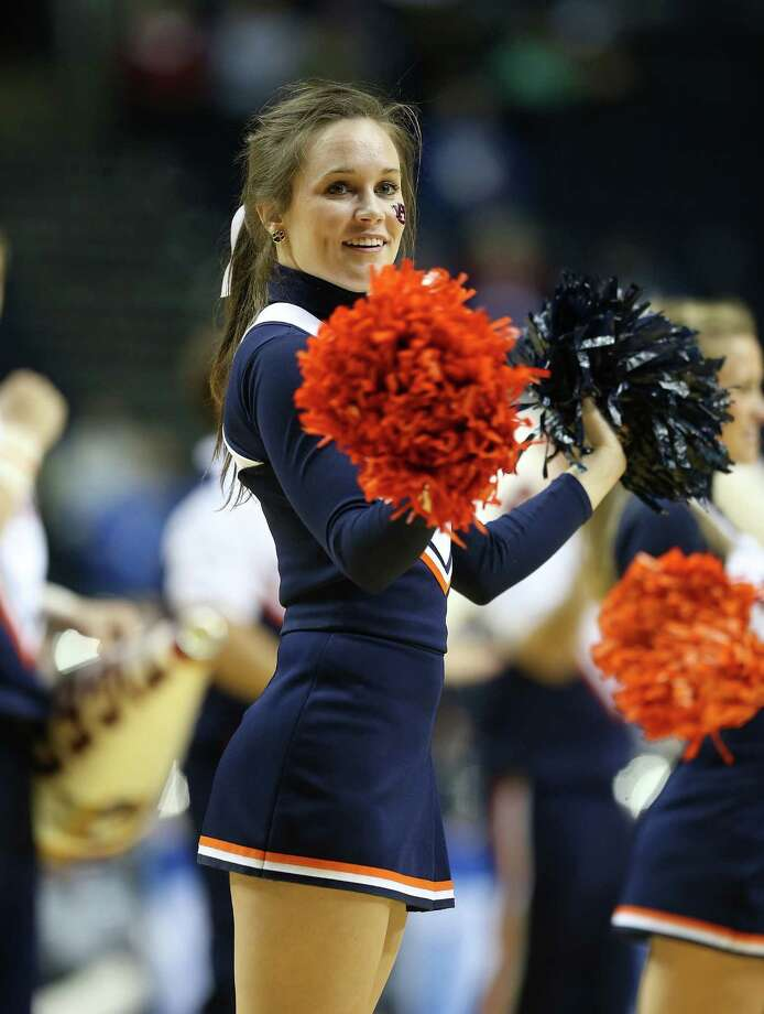 NASHVILLE, TN - MARCH 13:  A Auburn Tigers cheerleader performs during the game against the Texas A&M Aggies during the first round game of the Southeastern Conference Tournament at Bridgestone Arena on March 13, 2013 in Nashville, Tennessee. Photo: Andy Lyons, Getty Images / 2013 Getty Images