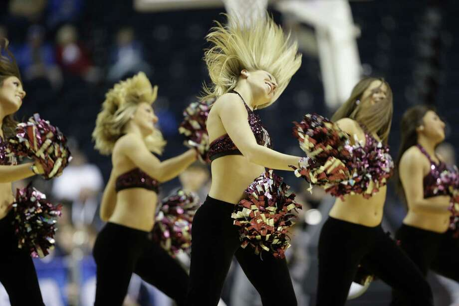 Texas A&M  cheerleaders perform during the second half of an NCAA college basketball game against Auburn at the Southeastern Conference tournament, Wednesday, March 13, 2013, in Nashville, Tenn. (AP Photo/Dave Martin) Photo: Dave Martin, Associated Press / AP