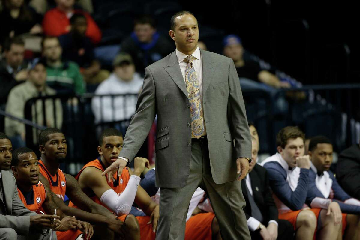 Auburn head coach Tony Barbee watches play against the Texas A&M during the first half of an NCAA college basketball game at the Southeastern Conference tournament in Nashville, Tenn., Wednesday, March 13, 2013. (AP Photo/Dave Martin)