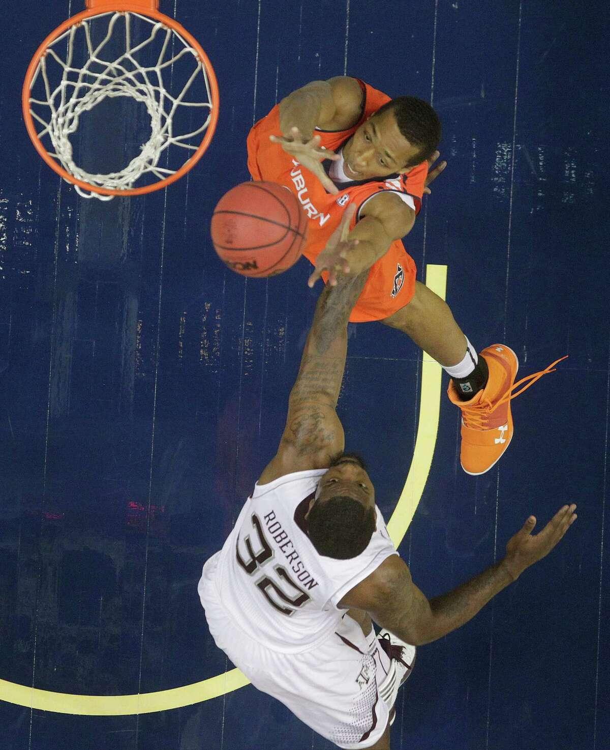 Auburn center Asauhn Dixon-Tatum (0) shoots as Texas A&M forward Kourtney Roberson (32) defends during the second half of an NCAA college basketball game at the Southeastern Conference tournament, Thursday, March 14, 2013, in Nashville, Tenn. Texas A&M won 71-62. (AP Photo/Dave Martin)