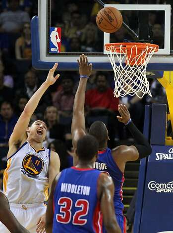 Golden State Warriors guard Klay Thompson (11) spins around and scores over Detroit Pistons defenders in the second half of their NBA basketball game Wednesday, March 13, 2013, in Oakland Calif. Photo: Lance Iversen, The Chronicle