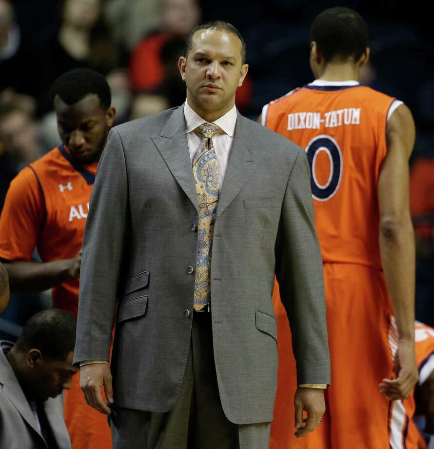 Auburn head coach Tony Barbee watches play against the Texas A&M during the first half of an NCAA college basketball game at the Southeastern Conference tournament in Nashville, Tenn., Wednesday, March 13, 2013. (AP Photo/Dave Martin) Photo: Dave Martin, Associated Press / AP