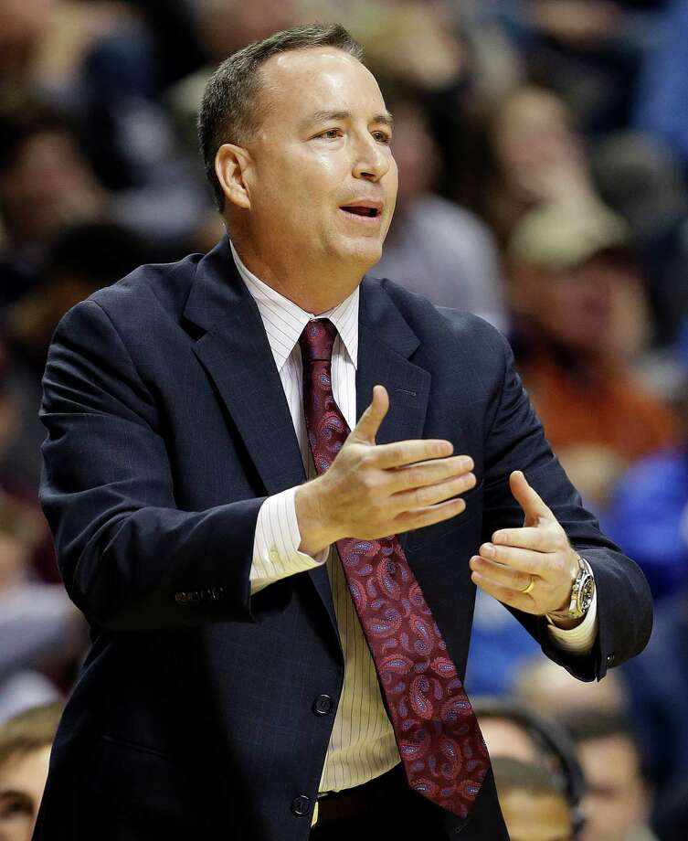 Texas A&M head coach Billy Kennedy gestures to players during the first half of an NCAA college basketball game against Auburn at the Southeastern Conference tournament, Wednesday, March 13, 2013, in Nashville. (AP Photo/Dave Martin) Photo: Dave Martin, Associated Press / AP