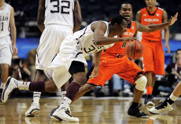 Texas A&M guard Elston Turner (31) moves the ball around Auburn guard Josh Wallace (11) during the second half of an NCAA college basketball game at the Southeastern Conference tournament, Wednesday, March 13, 2013, in Nashville, Tenn. (AP Photo/Mike Stewart) Photo: Mike Stewart, Associated Press / AP