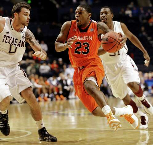 Auburn guard Frankie Sullivan (23) drives upcourt against Texas A&M forward Andrew Young (0) during the first half of an NCAA college basketball game at the Southeastern Conference tournament, Wednesday, March 13, 2013, in Nashville. (AP Photo/Dave Martin) Photo: Dave Martin, Associated Press / AP