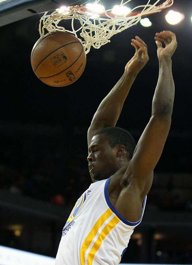 Golden State Warriors forward Harrison Barnes (40) scores in front of Detroit Pistons defenders in the first half of their NBA basketball game Wednesday, March 13, 2013, in Oakland Calif. Photo: Lance Iversen, The Chronicle