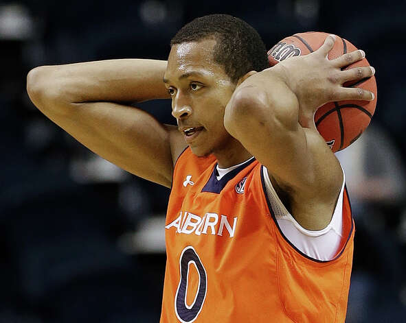Auburn center Asauhn Dixon-Tatum (0) reacts after a missed shot against Texas A&M during the first half of an NCAA college basketball game at the Southeastern Conference tournament, Wednesday, March 13, 2013, in Nashville. (AP Photo/Dave Martin) Photo: Dave Martin, Associated Press / AP