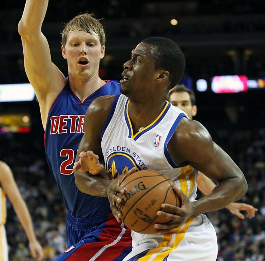 Golden State Warriors forward Harrison Barnes (40) drives the ball past Detroit Pistons defenders in the first half of their NBA basketball game Wednesday, March 13, 2013, in Oakland Calif. Photo: Lance Iversen, The Chronicle