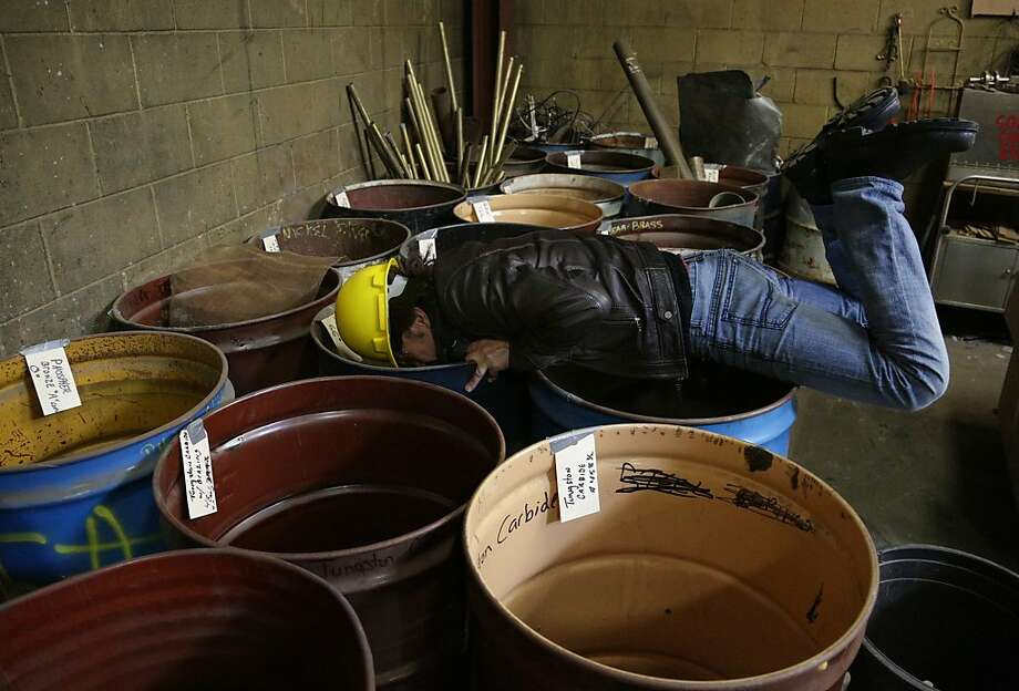 Greg Kozak of the Canadian group ScrapArtsMusic looks for pieces of scrap metal that might be used in the groups' performances, Wednesday, March 13, 2013, at Wausau Scrap and Recycling in Wausau, Wis. The group does percussive music with metal pieces rescued from the scrap heap. They were in Wausau for a performance, Wednesday night. (AP Photo/Daily Herald Media, Dan Young) Photo: Dan Young, Associated Press