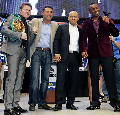 "Saul ""Canelo"" Alvarez (left) meets Austin Trout (right) at a promotional event for their title fight at the Alamodome.   Oscar de la Hoya and Jesse James Leija stand with the two before fans.  March 13, 2013. Photo: Tom Reel, San Antonio Express-News"
