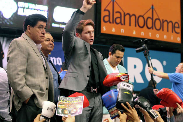 "Saul ""Canelo"" Alvarez salutes fans as he  meets Austin Trout at a promotional event for their title fight at the Alamodome.   March 13, 2013. Photo: Tom Reel, San Antonio Express-News"