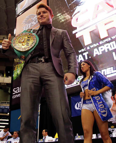"Saul ""Canelo"" Alvarez shows off his championship belt as he meets Austin Trout at a promotional event for their title fight at the Alamodome.   March 13, 2013. Photo: Tom Reel, San Antonio Express-News"