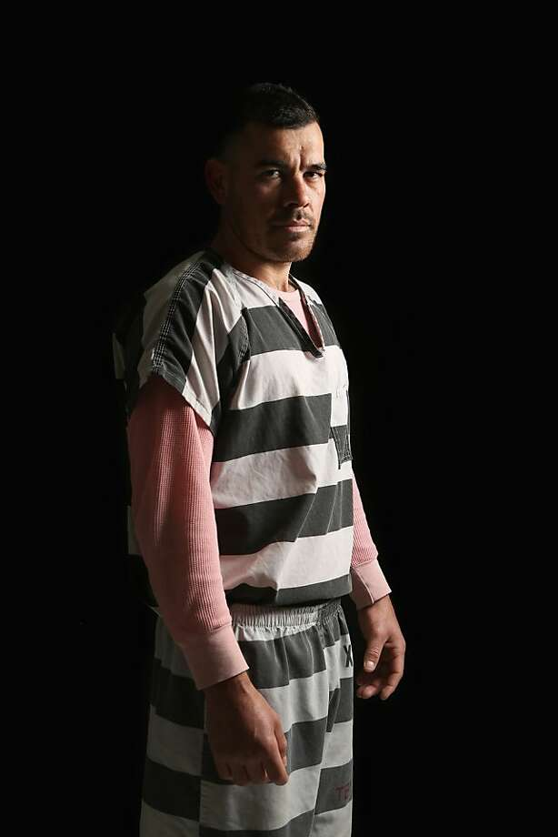 PHOENIX, AZ - MARCH 11:  An undocumented immigrant from Sinaloa, Mexico, 28, poses for a portrait as he serves time in the Maricopa County Tent City jail on March 11, 2013 in Phoenix, Arizona. The jail, run by county Sheriff Joe Arpaio, maintains a controversial policy of issuing striped uniforms and pink undergarments to inmates, despite an ongoing court challenge. The immigrant preferred not to give his name, but said he has worked as a migrant farm laborer for 6 months each year in the U.S. for the last decade. He said he was stopped on a traffic violation and jailed for driving without a license. As an undocumented immigrant with a criminal record, he may be deported to Mexico after serving his jail sentence. President Barack Obama's administration deported a record 1.5 million people during his first term of office with 55 percent of deportees in 2012 having a criminal conviction for drug offenses or driving under the influence, according to U.S. immigration officials.  (Photo by John Moore/Getty Images) Photo: John Moore, Getty Images