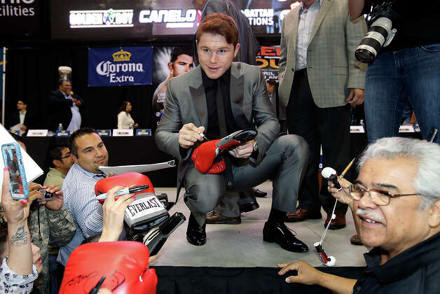 "Saul ""Canelo"" Alvarez signs autographs as he meets Austin Trout at a promotional event for their title fight at the Alamodome.   March 13, 2013. Photo: TOM REEL, San Antonio Express-News / San Antonio Express-News"
