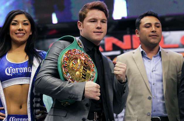 "Saul ""Canelo"" Alvarez holds his championship belt as he meets Austin Trout at a promotional event for their title fight at the Alamodome.   March 13, 2013. Photo: TOM REEL, San Antonio Express-News / San Antonio Express-News"