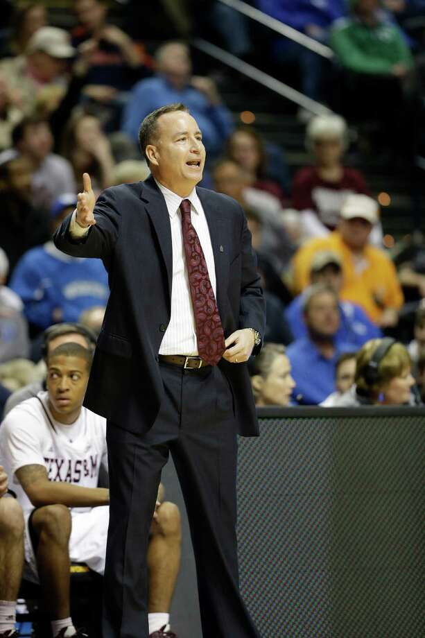 Texas A&M head coach Billy Kennedy speaks to players during the first half of an NCAA college basketball game against Auburn at the Southeastern Conference tournament, Wednesday, March 13, 2013, in Nashville. (AP Photo/Dave Martin) Photo: Dave Martin, Associated Press / AP