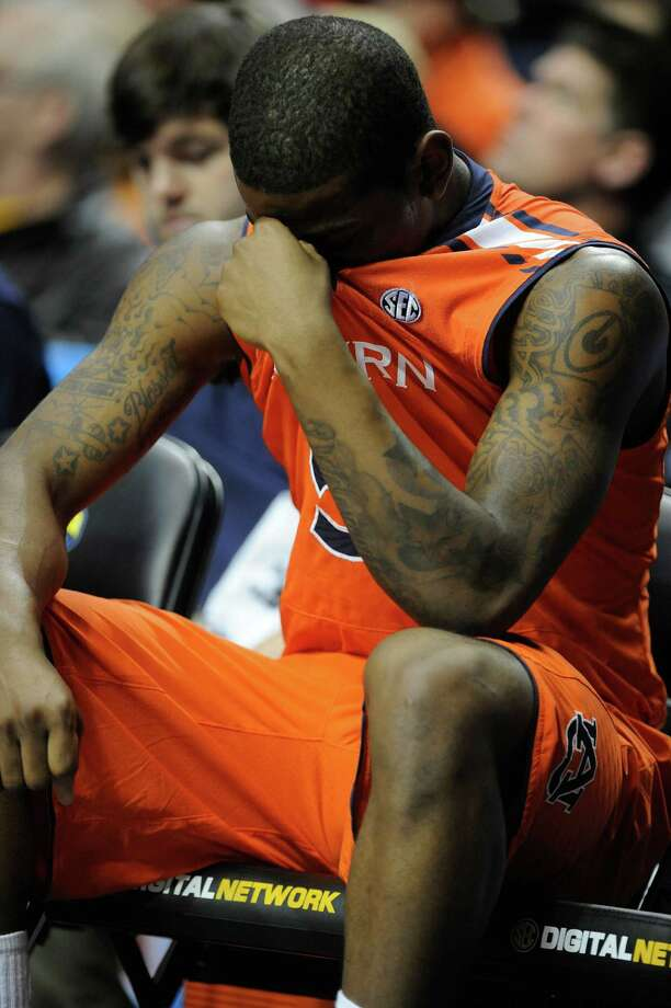 Auburn forward Shaquille Johnson (5) sits on the bench after an injury during the second half of an NCAA college basketball game against the Texas A&M  at the Southeastern Conference tournament, Wednesday, March 13, 2013, in Nashville, Tenn. (AP Photo/Mike Stewart) Photo: Mike Stewart, Associated Press / AP