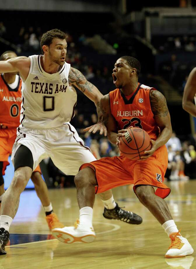 Alabama forward Cade Johnson (23) works against Texas A&M forward Andrew Young (0)during the first half of an NCAA college basketball game at the Southeastern Conference tournament, Wednesday, March 13, 2013, in Nashville. (AP Photo/Dave Martin) Photo: Dave Martin, Associated Press / AP