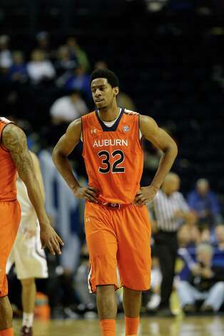 Auburn forward Noel Johnson (32) walks on the court after a play against Texas A&M during the second half of an NCAA college basketball game at the Southeastern Conference tournament, Wednesday, March 13, 2013, in Nashville, Tenn. (AP Photo/Dave Martin) Photo: Dave Martin, Associated Press / AP