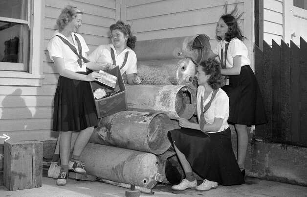 March 1942: This was the earliest photo in the Chronicle 'Girl Scouts' file. I'm getting a strong Grease/Pink Ladies vibe from this quartet. Girl Scout cookie history in the U.S. dates back to 1917, but the first Chronicle story documenting sales in San Francisco appeared in 1947. Photo: Chronicle Staff, The Chronicle / ONLINE_YES