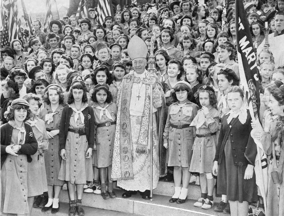 March 6, 1949: Girl Scouts from San Francisco meet with Archbishop John J. Mitty, immortalized by Mitty High School. An impressive figure -- I can't believe this guy was passed over for Pope. Based on the photos and articles, scouting had strong religious ties in the early years. Photo: Ken McLaughlin, The Chronicle / ONLINE_YES