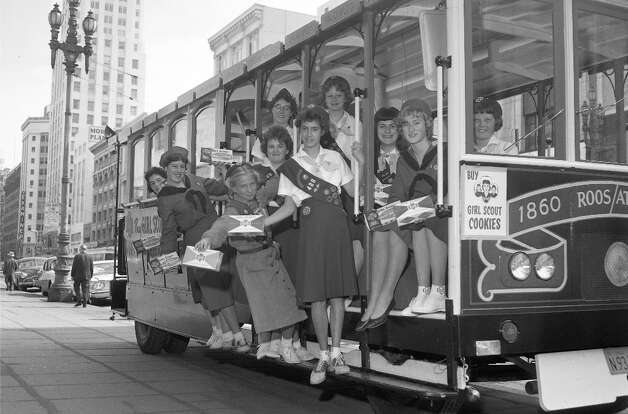May 27, 1960: Girl Scouts kick off their latest cookie sale on a motorized cable car knockoff, which would zip around the city while the girls hung on and offered cookie-themed songs. Proof that Girl Scouts were resourceful, and vehicle safety laws were next to nonexistent in 1960. Photo: Peter Breinig, The Chronicle / ONLINE_YES