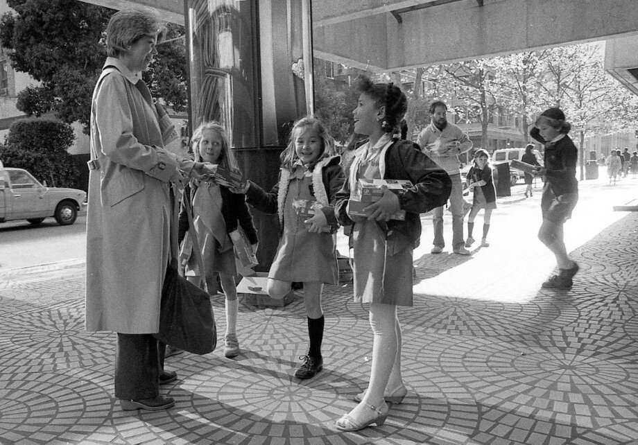April 4, 1984: Brownie troop 167 sells Girl Scout cookies at the Embarcadero Center in San Francisco. You can see them operating with the classic cookie sale flanking technique. Based on the photos, 1980s Girl Scouts hunted exactly like the velociraptors in Jurassic Park. Photo: Chris Stewart, The Chronicle / ONLINE_YES
