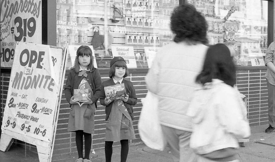 Mar. 29, 1988: What kind of cold-hearted person *wouldn't* buy cookies from these Girl Scouts. I'm assuming they're sisters. If you know them, please have them contact me at phartlaub@sfchronicle.com. I'd like an interview for my Let's Go to the Q&A project. Photo: Deanne Fitzmaurice, The Chronicle / ONLINE_YES