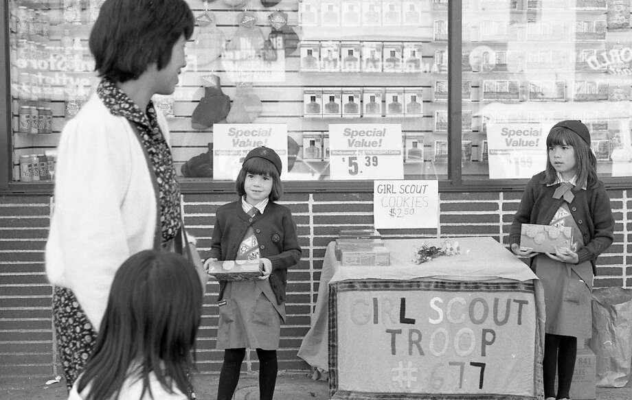 March 29, 1988: One more photo, showing the cookie prices and Girl Scout troop number. Cookie prices shot up from 35 cents to $2.50 between 1952 and 1988, with a controversial 50 cent hike in 1991. But they've only climbed another $1 per box in the 22 years since. Photo: Deanne Fitzmaurice, The Chronicle / ONLINE_YES