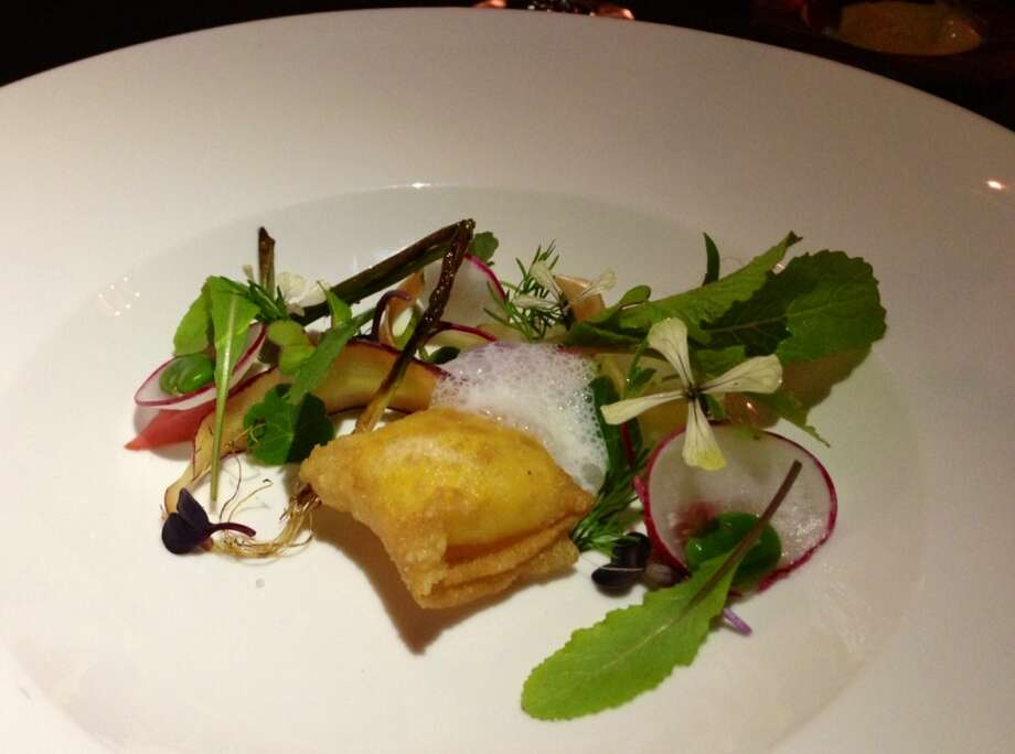 Sous vide egg wrapped in pastry with spring lettuces