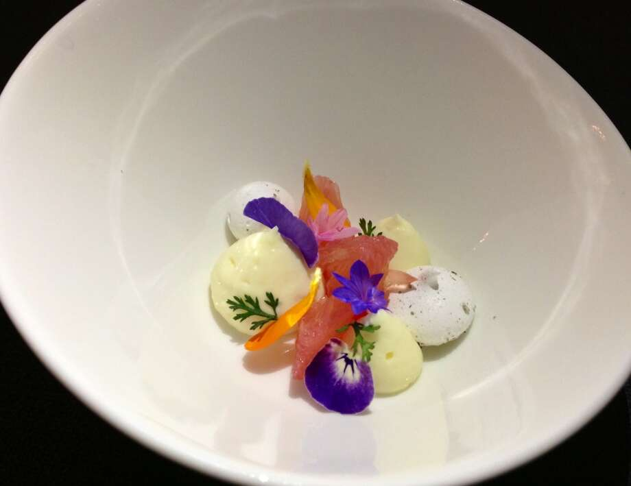 Bergamot curd palate-cleanser with sweet woodruff meringue and yarrow