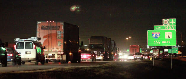 Traffic stacks up on the northbound lanes of Interstate 35 near Loop 410 South and Fischer Road after a wrong way driver crashed off a bridge about 3:30 a.m. Thursday March 14, 2013. The driver of the vehicle died and a female passenger in the vehicle was rushed to an area hospital in critical condition. Photo: JOHN DAVENPORT, San Antonio Express-News / ©San Antonio Express-News/ Photo may be sold to the public