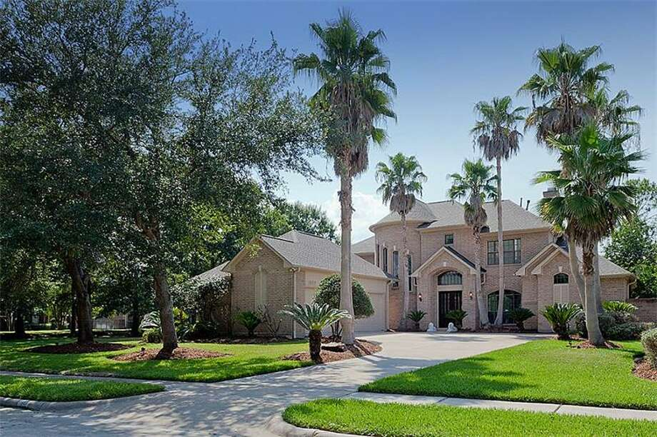 This Clear Lake home offers beautiful views of a nearby golf course and gorgeous amenities, including an upstairs game room. The home has three bedrooms and three bathrooms. Photo: Better Homes And Gardens