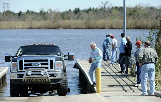 Spectators watch as anglers begin to head to the dock after some practice for the B.A.S.S. Bassmasters 2013 Elite Series Sabine River Challenge which begins on Thursday, March 14, 2013 at the City of Orange Boat Dock. Photo taken: Randy Edwards/The Enterprise