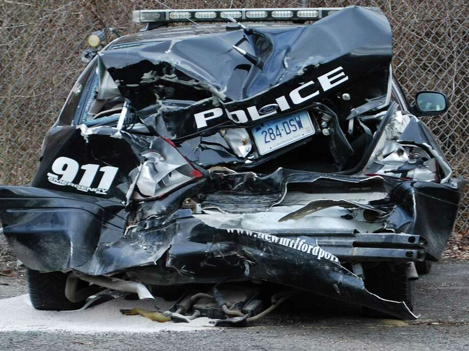 A New Milford police cruiser was much the worse for wear Thursday, March 14, 2013 after being struck during the early-morning hours by a vehicle driven by Brian Carey of Pennsylvania, police said. Photo: Deborah Rose