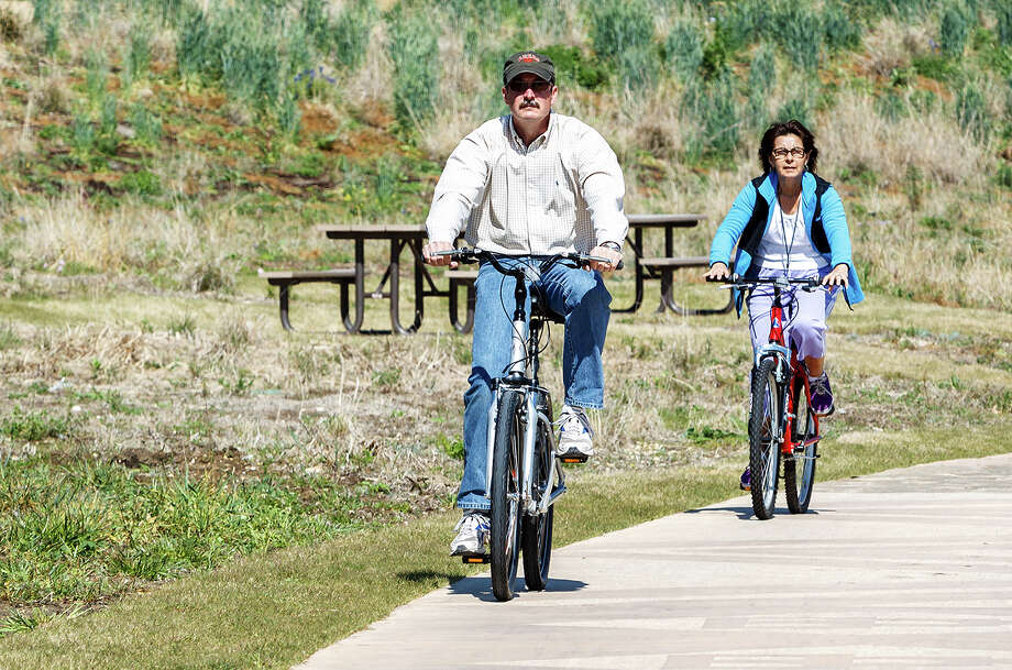 Dan and Kathy Hassenger of Bergheim ride their bikes down Mission Reach in Padre County Park on Wednesday, March 13, 2013.  MARVIN PFEIFFER/ mpfeiffer@express-news.net Photo: MARVIN PFEIFFER, Marvin Pfeiffer/ Express-News / Express-News 2013