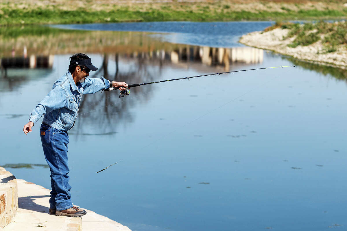Thomas Benitez casts a plastic worm into the San Antonio River while enjoying the day at Padre County Park on the Mission Reach on Wednesday, March 13, 2013. MARVIN PFEIFFER/ mpfeiffer@express-news.net