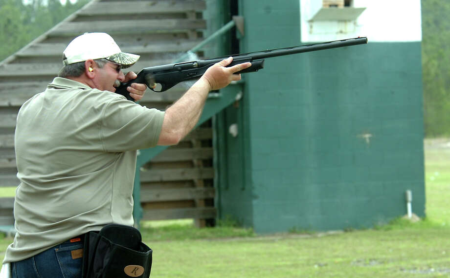 "Carroll Fontenot fires his rifle during the ""Shoot out at the LIT Corral"" at the 1 in 100 Gun Club in Lumberton, Saturday. Tammy McKinley/The Enterprise Photo: TAMMY MCKINLEY / Beaumont"