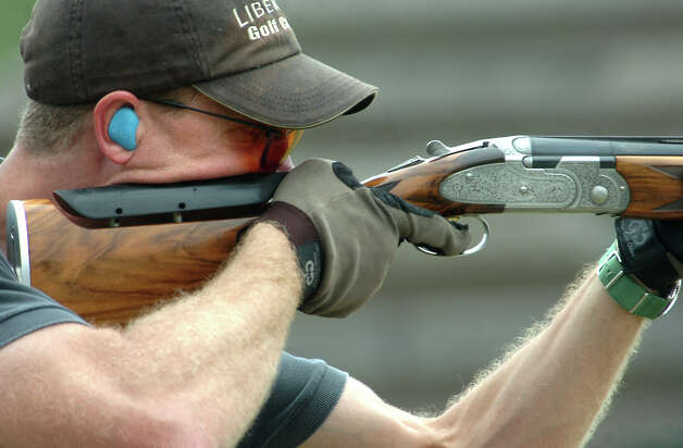 "John Field aims his rifle during the ""Shoot Out at the LIT Corral"" at the 1 in 100 Gun Club in Lumberton, Saturday. Tammy McKinley/The Enterprise Photo: TAMMY MCKINLEY / Beaumont"