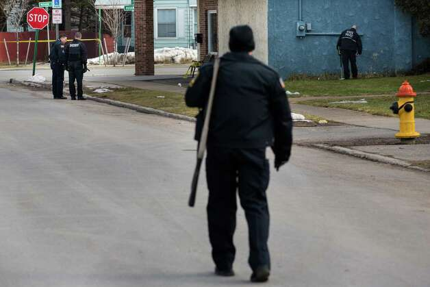 HERKIMER, NY - MARCH 13:  Police officers search the area around Gaffey's Fast Lube and Car Wash where a gunman shot and killed two people on March 13, 2013 in Herkimer, New York.  Police have identified 64-year-old Kurt Meyers as a possible suspect responsible for a total of four shooting deaths and two injuries across the Herkimer area earlier in the day. Photo: Brett Carlsen, Getty Images / 2013 Getty Images