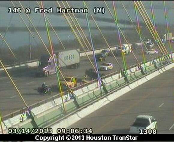 Traffic was slowed on Texas 146 at the Fred Hartman Bridge after a wreck Thursday morning. Photo: Houston Transtra