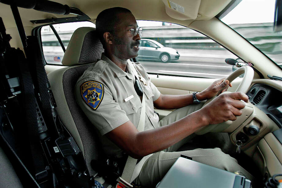 Sam Morgan an officer with the California Highway Patrol drives on highway 80 east bound through Berkeley looking for people talking on their cell phones without a hands free device on Tuesday, July 1, 2008 in Berkeley , Calif.Photo by Kurt Rogers / The Chronicle. Photo: Kurt Rogers, The Chronicle / SFC