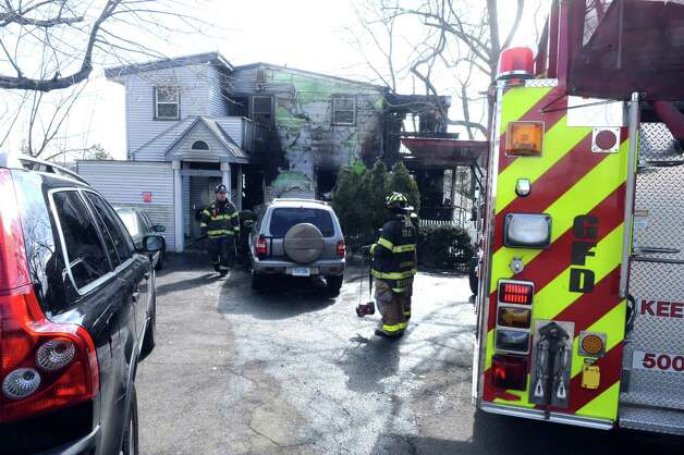 A home on Ritch Ave, burned overnight, Greenwich, Conn., Thursday, March 14, 2013 Photo: Helen Neafsey / Greenwich Time