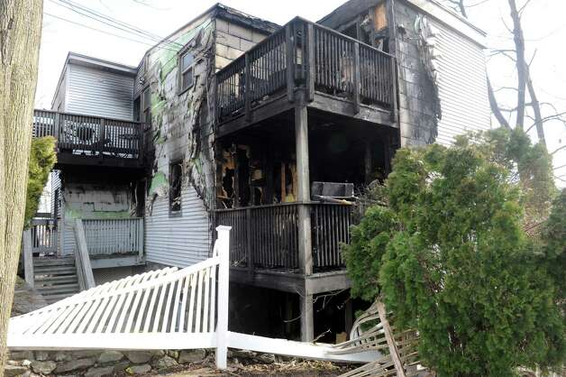 A home on Ritch Ave, burned overnight, Greenwich, Conn., Thursday, March 14, 2013. Photo: Helen Neafsey / Greenwich Time