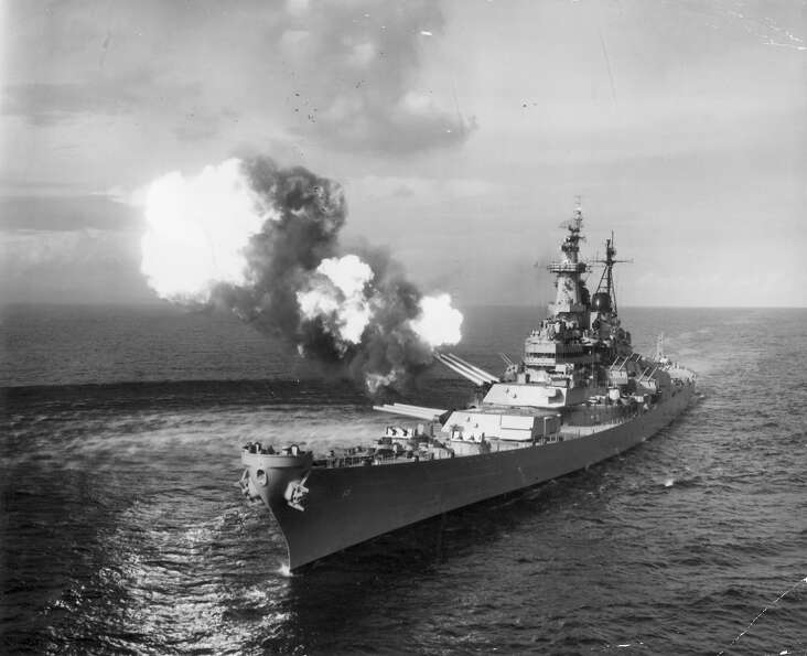 The battleship USS Missouri bombards Chongjin, North Korea, with her 16 inch guns during a mission t