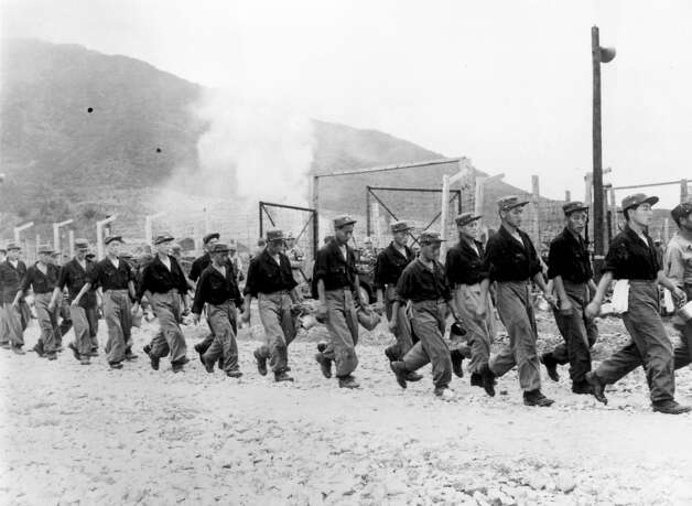 1953:  North Korean prisoners of war leaving a prison camp on Koja island to be transported to Inchon under a recent armistice. Photo: Central Press, Getty Images / Hulton Archive