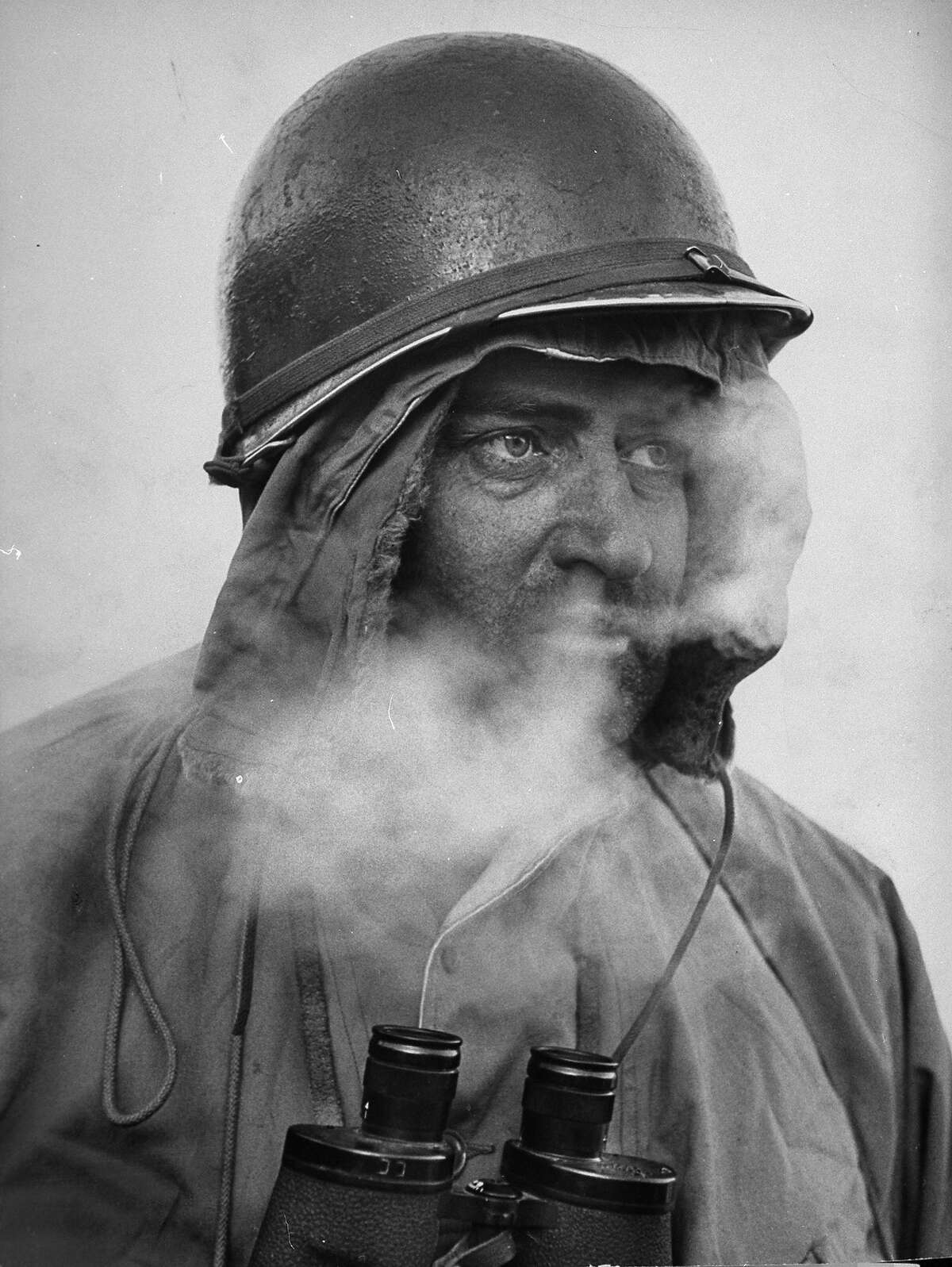 1950: U.S. Army Major Carroll Cooper showing signs of exhaustion after going w/o sleep for three days and three nights in very cold weather during pursuit of North Koreans though the gorges of the Yalu River.