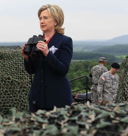 Secretary of State Hillary Clinton looks toward North Korea during a visit to observation post Ouellette at the Demilitarized Zone (DMZ), on July 21, 2010 in Panmunjon, South Korea.  The DMZ is a strip of land that divides North and South Korea at the 38th parallel. Sixty years ago on June 25, 1950, North Korean forces crossed the parallel and invaded South Korea starting the Korean War. Photo: Mark Wilson, Getty Images / 2010 Getty Images