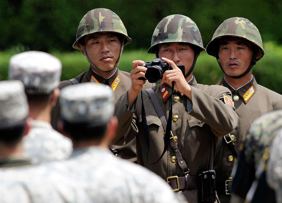North Korean soldiers look at U.S. soldiers during the 57th anniversary of signing the ceasefire agreement ceremony on July 27, 2010 in Panmunjom, South Korea. United States and South Korea are operating a joint military exercise while marking 57th anniversary of signing the ceasefire agreement of Korean War between 1950 to 1953. The exercise, first joint drill after the sinking of South Korean warship in March 2010, is taking place for four days, and has drawn condemnation from Pyongyang. Photo: Pool, Getty Images / 2010 Getty Images